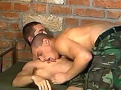 Handsome army boy cums on his assistant after oral